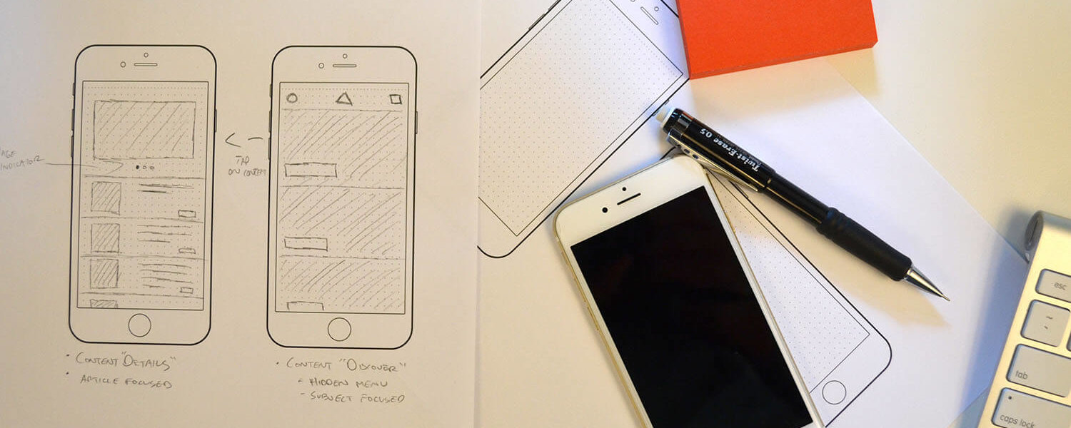 app design UX wireframe sketches on paper