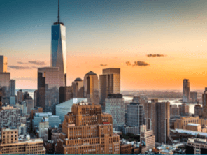 New York City Freedom Tower and skyline at sunset