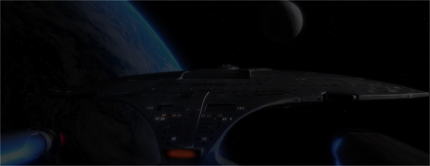 Star Trek spacecraft flying in front of planets