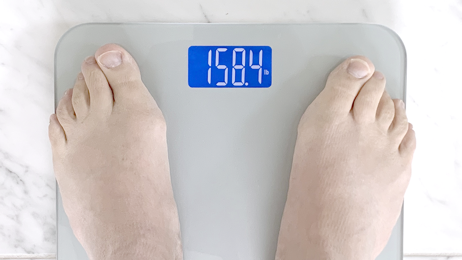 feet on a scale showing current weight