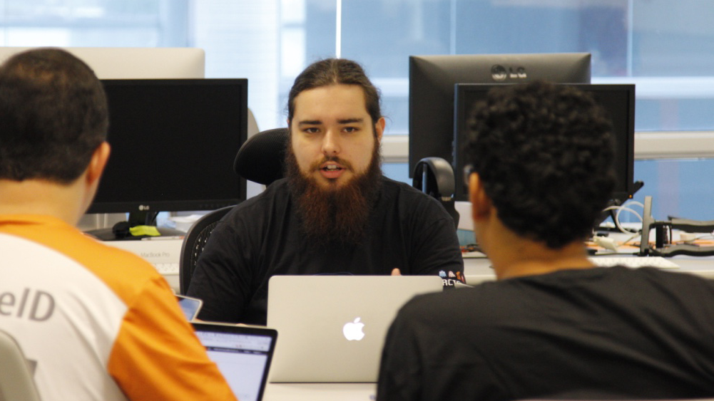 ArcTouch engineering manager Oberdan Ferreira speaking with Xamarin app developers